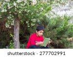 Little Boy Reading A Book...