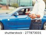 male hand holding car keys... | Shutterstock . vector #277873031