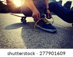 skateboarder tying shoelace at... | Shutterstock . vector #277901609