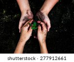 Kid And Mom Red Hand Plant The...