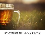 mug of beer on the grass | Shutterstock . vector #277914749