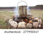 cooking over a campfire | Shutterstock . vector #277950317
