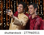 men with camera taking a self...   Shutterstock . vector #277960511