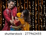 man trying to snatch gifts from ... | Shutterstock . vector #277962455