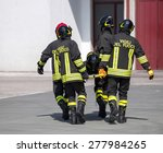 four brave firefighters carry a ... | Shutterstock . vector #277984265