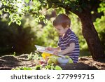 Beautiful Kid Boy  Reading A...