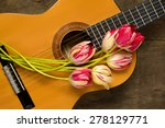 guitars and tulips on wooden... | Shutterstock . vector #278129771