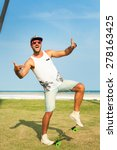 Small photo of Young handsome hipster man relaxed at sunny day on the park, after training,wearing stylish shirt and bright sunglasses,skateboard.smiles and laughs,hipster cap,swagger man,mans fashion,summer outfit