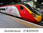Small photo of LONDON, ENGLAND -8 JULY 2014- Virgin trains to Coventry and Birmingham leave London from the Euston Station.