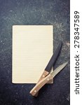 the sheet of paper with knives - stock photo