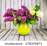 Lilac Flower In A Green Vase On ...