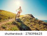 man on a mountain bike races... | Shutterstock . vector #278398625