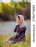muslim woman reading holy quran | Shutterstock . vector #278474885