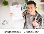 portrait of teenager sitting at ... | Shutterstock . vector #278560454