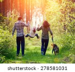 Stock photo happy family walking with dog in the forest 278581031