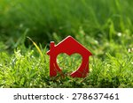 Small Model Of House Over Gree...