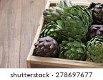 Artichokes In Wooden Box