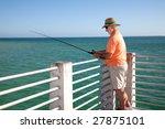 Senior Man In Straw Hat Fishing ...