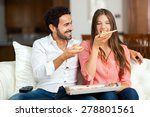 couple with pizza and tv remote  | Shutterstock . vector #278801561