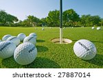 practice golf balls on putting green - stock photo