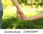 a the parent holding the hand... | Shutterstock . vector #278920997