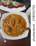Small photo of Chicken Goan Xacuti is a curry prepared in Goa, India with complex spices