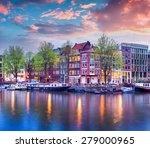 Stock photo colorful spring sunset on the canals of amsterdam authentic dutch architecture in the capital and 279000965