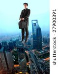business man flying over a city | Shutterstock . vector #27900391