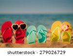 beach flip flops on the sand.... | Shutterstock . vector #279026729