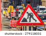 Old Roadworks Sign On A Busy...