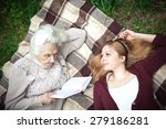 grandmother reading a story to... | Shutterstock . vector #279186281