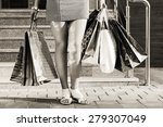 woman with shopping bags... | Shutterstock . vector #279307049