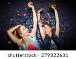 Two Energetic Girls Dancing In...