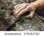 Woman Climbing On Rock Outdoor...