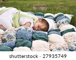 Amish Child Lying Outdoors On ...