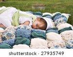 Amish Child Lying Outdoors On ...