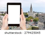 Small photo of travel concept - tourist photograph cityscape with St Laud's Church in Angers, France on tablet pc with cut out screen with blank place for advertising logo