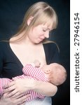 mother breast feeding her... | Shutterstock . vector #27946154