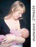 mother breast feeding her... | Shutterstock . vector #27946154