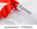 Diploma with red ribbon on white background - stock photo
