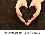 Female Handful Of Soil In Shap...