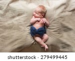 naked newborn baby sleeps  | Shutterstock . vector #279499445