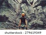 Young Woman Wearing In Climbin...
