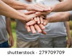 happy volunteer family putting... | Shutterstock . vector #279709709
