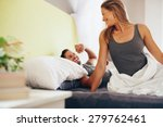 happy young couple waking up in ... | Shutterstock . vector #279762461