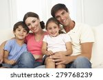 family relaxing on sofa at home ... | Shutterstock . vector #279768239