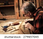 senior carpenter restoring old... | Shutterstock . vector #279857045