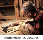 senior carpenter restoring old... | Shutterstock . vector #279857045