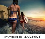 Two Ladies Surfers Running Wit...
