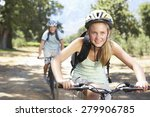 teenage couple cycling through... | Shutterstock . vector #279906785